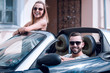 young couple in convertible car.