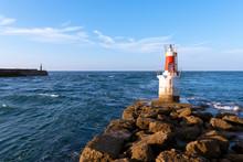 Lighthouse On Rocky Coastline