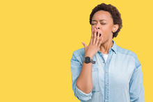 Young Beautiful African American Woman Over Isolated Background Bored Yawning Tired Covering Mouth With Hand. Restless And Sleepiness.
