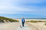 Man with dog in landscape beach