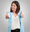 canvas print picture - Middle aged woman cheerful and excited, smiling and raising her thumb up, concept of success and approval, ok gesture