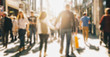 crowd of people in a shopping street, defocused background