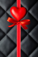 Red Heart, Bow And Ribbon On Black Quilted Leather
