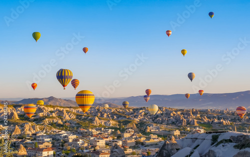 Fototapety, obrazy: Colorful hot air balloons flying over rock landscape at Cappadocia Turkey