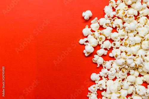 Fotografie, Obraz  Tasty salted popcorn isolated on red background