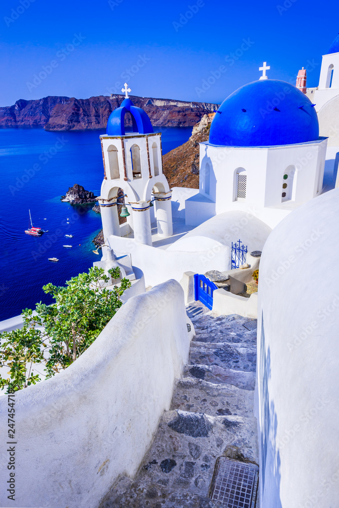 Fototapeta Oia, Santorini, Greece - Blue church and caldera