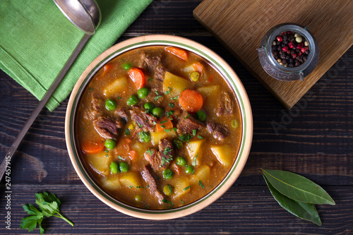 Traditional Irish lamb stew with vegetables. View from above, top studio shot