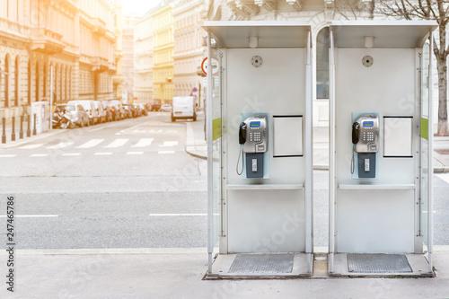 Obraz na plátně  Pair of payphone booth in Vienna center street