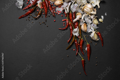Photo Stands Hot chili peppers Red hot chili peppers and garlic, on sackcloth, on wooden background