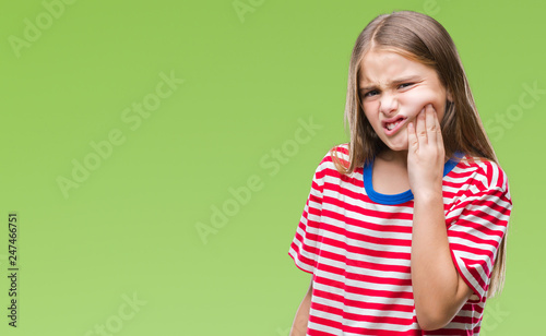 Fotografia  Young beautiful girl over isolated background touching mouth with hand with painful expression because of toothache or dental illness on teeth