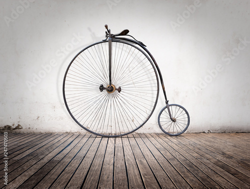 Aluminium Prints Bicycle penny-farthing, high wheel retro bike on wood floor