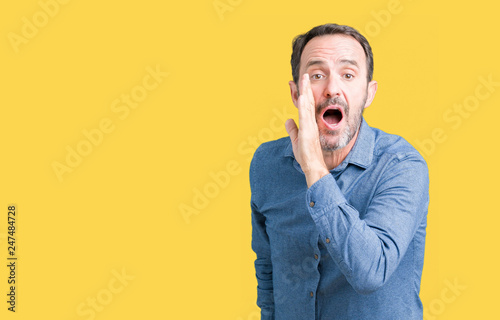 Fotografie, Obraz  Handsome middle age elegant senior man over isolated background hand on mouth te
