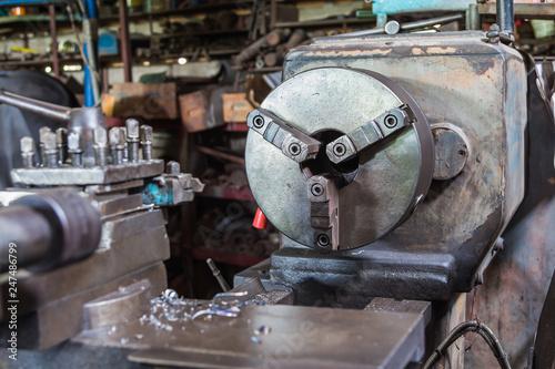 Photo  Chuck of old lathe machine