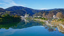 Panorama Of Nelson City, Reflected In The Maitai River, New Zealand.