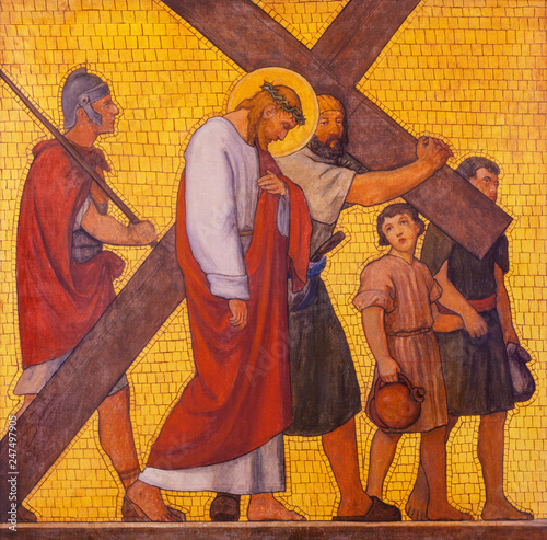 PRAGUE, CZECH REPUBLIC - OCTOBER 17, 2018: The painting Simon of Cyrene helps Jesus carry the cross in the church kostel Svatého Cyrila Metodeje by  S Wallpaper Mural