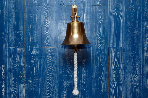 Fotografie, Obraz Copper old vintage bell, doorbell, rope on a wooden blue aged wall