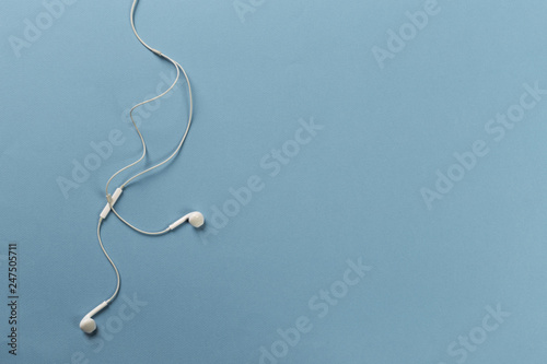 Foto op Aluminium Vissen White earphones on blue background