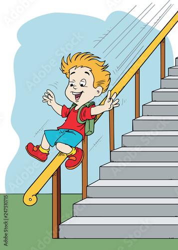 Fotografiet boy sliding down the banister