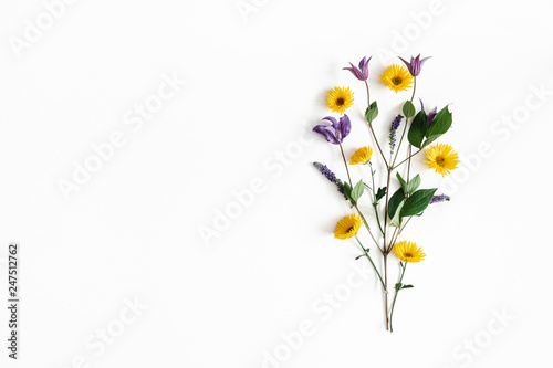 Fototapety, obrazy: Flowers composition. Yellow and purple flowers on white background. Spring, easter concept. Flat lay, top view, copy space