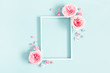 canvas print picture - Flowers composition. Photo frame, rose flowers on pastel blue background. Valentines day, mothers day, womens day, spring concept. Flat lay, top view, copy space