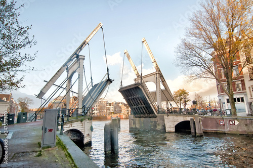 Drawbridge is opening in the centre of Amsterdam,  Netherlands. Wallpaper Mural