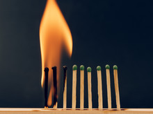 Sulfur Matches Are Burning On A Black Background