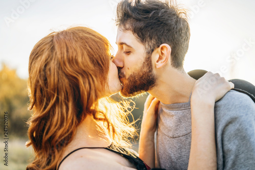 Fototapeta Pretty young romantic couple spend time together outdoor. obraz