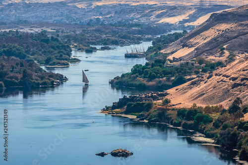 Sunset over the Nile River in the city of Aswan with sandy and deserted shores Canvas Print