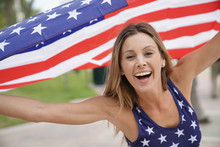 Proud Attractive Woman Flying American Flag Outdoors