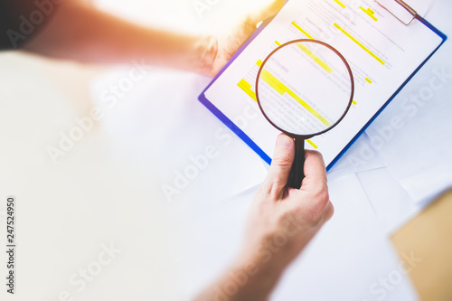 Obraz Legal team checking the fine print on business contract to analyze terms and conditions and sign. - fototapety do salonu