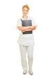canvas print picture Zufriedene Krankenschwester mit Klemmbrett
