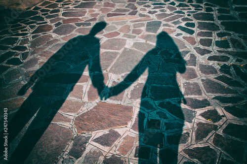 Silhouette shadow of two people holding hands together in the city ... 83c7ec805a