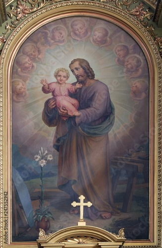 Fotografering Saint Joseph holding baby Jesus, altarpiece in the Basilica of the Sacred Heart