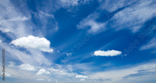 Blue sky background with tiny clouds - 247553151