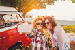 canvas print picture - Nice attractive couple of middle age woman travel together with old red van vintage and take selfie with modern phone during outdoor picnic leisure activity - sunny day of summer vacation