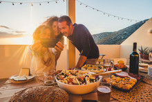 Group Of Friends Celebrate Together Outdoor In The Terrace With A Table Full Of Food And Drinks And Take Selfie Having Fun - Friendship Concept For Adult Man And Women Enjoying Meals Celebrate Summer