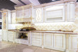 Chernivtsi/Ukraine-01.05.2019: Classic style kitchen and dining room interior in beige pastoral colors