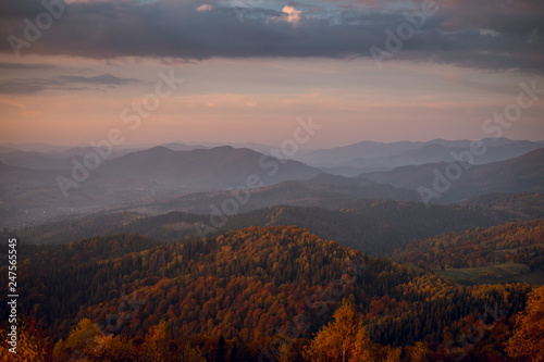 Keuken foto achterwand Bruin Aerial view of autumn mountains with colorful forest on sunset. Mountains in mist. Scenic landscape