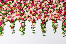 Spring And Summer Background - Close Up Of Colorful Composition With Artificial Flowers Over White Wall