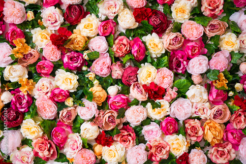 Fotografie, Tablou  wedding decoration - close up of colorful artificial flowers wall background