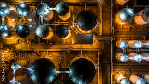 Fototapeta Liquid chemical tank terminal, Storage of liquid chemical and petrochemical products tank, Aerial view at night. obraz