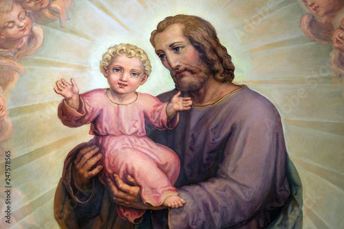 Photo Saint Joseph holding baby Jesus, altarpiece in the Basilica of the Sacred Heart