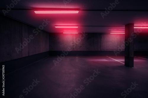 Fototapeta dark underground car parking deck with neon red light  -
