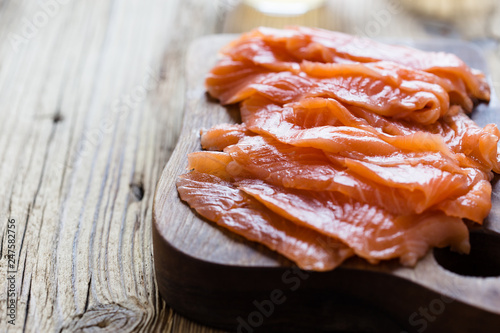 Papiers peints Pays d Afrique Smoked salmon on wooden board, sliced