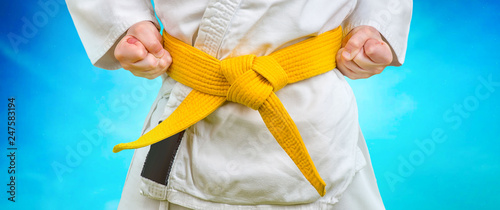Fotografía  Kimono and yellow belt. The sportsman is standing.