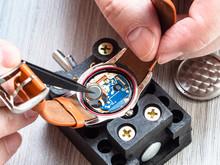 Watchmaker Repairs Quartz Wristwatch Close Up