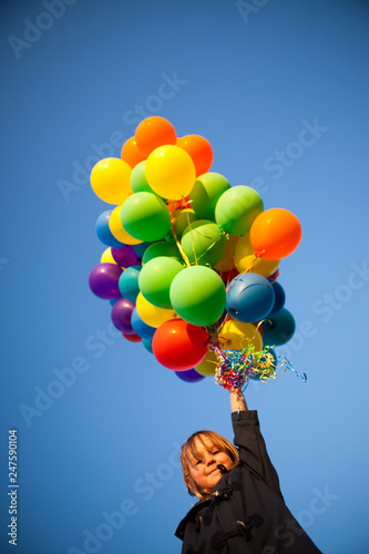 Photo  Happy Little Girl Holding Bunch of Balloons