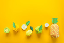 Fruit Made Of Paper. Yellow Background. There's Room For Writing. Tropics. Flat Lay. Pineapple, Apple, Lemon, Banana And Kiwi.