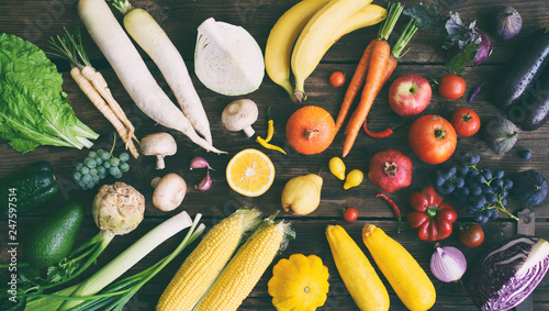 Fotografie, Obraz  White, yellow, green, orange, red, purple fruits and vegetables on wooden background