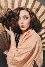 Woman Poses With Fan And Kimono